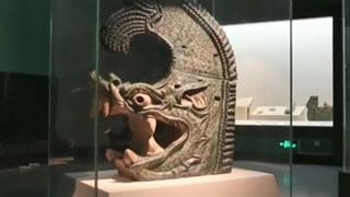 考古学家挖掘出巨型神兽 龙头鱼尾震惊考古界