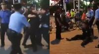 【广东】城管不配合还动手 被制服大哭:警察打警察